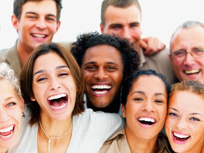 Multicultural group of adults laughing