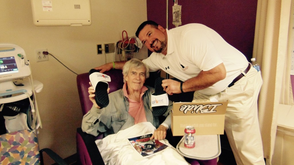 Joe Andruzzi giving Upbeat Cancer ISlides to patient at beth israel deaconess in Plymouth, MA