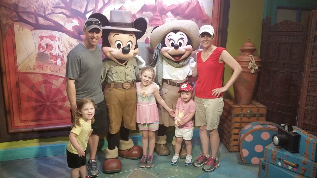 Andrea Vandette & family take picture with Mickey & Minnie Mouse at Disney World
