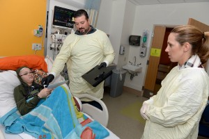 BOSTON, MA - JANUARY 26: Joe Andruzzi, and Jen Andruzzi (R) visit with Cameron at Boston Children